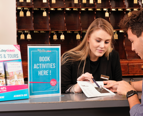 Receptionist explaining ticket to guest