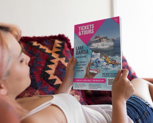Woman reading promo print activity brochure
